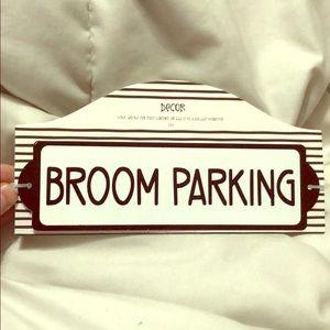 Broom Parking metal sign.